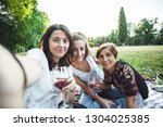 mother and daughters take... | Shutterstock . vector #1304025385