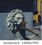 public faucet with a lion's... | Shutterstock . vector #1304027992