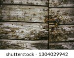 old  locked house door in lucca ... | Shutterstock . vector #1304029942