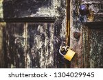old  locked house door in lucca ... | Shutterstock . vector #1304029945