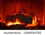 Small photo of Background of burning hot coals.Coals in the brazie.Embers and fire above firebrand in hearth, shallow DOF. Embers in the fireplace