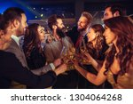 young friends drinking... | Shutterstock . vector #1304064268