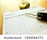 Car key on the calendar for appointment reminder of installment pay or service maintenance reservation concept. - stock photo