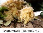sauerkraut on a fork with a...   Shutterstock . vector #1304067712