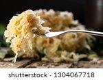 sauerkraut on a fork with a...   Shutterstock . vector #1304067718