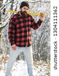 lumberjack in the woods with an ... | Shutterstock . vector #1304111362