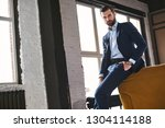 confident young bearded brunet...   Shutterstock . vector #1304114188
