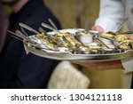 waiter carrying plates with... | Shutterstock . vector #1304121118
