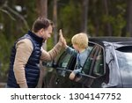 cute little boy and his father... | Shutterstock . vector #1304147752