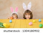 funny kids wearing easter bunny.... | Shutterstock . vector #1304180902