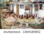 sweet buffet table | Shutterstock . vector #1304185852