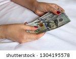 us dollars in female hands ... | Shutterstock . vector #1304195578
