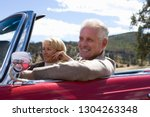 mature couple on road trip in... | Shutterstock . vector #1304263348
