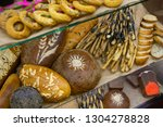 fresh bread and various buns on ... | Shutterstock . vector #1304278828