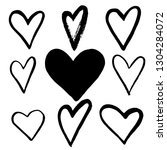 set of black hand drawn hearts... | Shutterstock .eps vector #1304284072