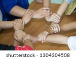 young team putting hands up for ... | Shutterstock . vector #1304304508