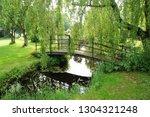 old wrought iron bridge spans a ...   Shutterstock . vector #1304321248