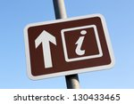 Brown Tourist Information directional sign.