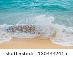 the waves hit the timber... | Shutterstock . vector #1304442415