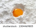 closeup egg yolk in flour   Shutterstock . vector #1304469805
