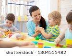 tutor teaches children... | Shutterstock . vector #1304555482