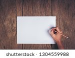 top view hand with blank white... | Shutterstock . vector #1304559988