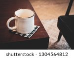 coffee cup on wooden table | Shutterstock . vector #1304564812