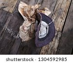 old hand made hats and dirty... | Shutterstock . vector #1304592985