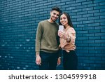 cheerful couple in love ... | Shutterstock . vector #1304599918