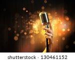 female hand holding a single... | Shutterstock . vector #130461152