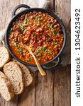delicious cowboy stew of beans... | Shutterstock . vector #1304623492