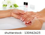 woman in a nail salon receiving ... | Shutterstock . vector #130462625