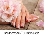 woman in a nail salon receiving ...   Shutterstock . vector #130464545