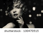 Stock photo monochrome picture of elegant blond retro woman wearing little hat with veil 130470515