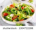 fresh salad with avocado ... | Shutterstock . vector #1304722288