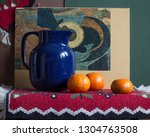 Jug With Tangerines On Red....