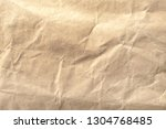 brown crumpled paper texture... | Shutterstock . vector #1304768485