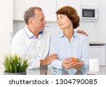 unhappy mature couple sittimg... | Shutterstock . vector #1304790085