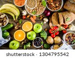 Small photo of Healthy food. Selection of good carbohydrate sources, high fiber rich food. Low glycemic index diet. Fresh vegetables, fruits, cereals, legumes, nuts, greens. Wooden background copy space