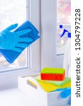 a hand in rubber glove washes a ... | Shutterstock . vector #1304797228