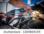 servicing car air conditioner.... | Shutterstock . vector #1304804155