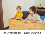 father and son assembling... | Shutterstock . vector #1304905465