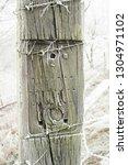 reclaimed railway sleeper fence ... | Shutterstock . vector #1304971102
