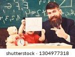 teacher and pupil in... | Shutterstock . vector #1304977318