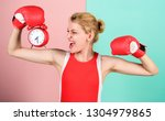 Small photo of Girl athlete boxing gloves and alarm clock. Sport lifestyle and healthy regime. Habits and regime concept. Improve yourself. Overcome harmful habits. Time for training. Get used to personal regime.