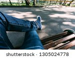 the guy in jeans and sneakers... | Shutterstock . vector #1305024778