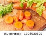 macro sliced carrot on wooden... | Shutterstock . vector #1305030802