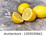 fresh lemon on table.... | Shutterstock . vector #1305030862