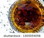 close up inside a glass of a... | Shutterstock . vector #1305054058