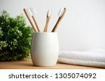 Four bamboo toothbrushes in a...